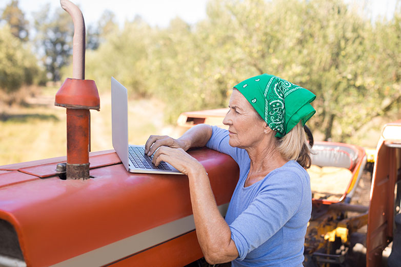 Female farmer using the internet from her tractor