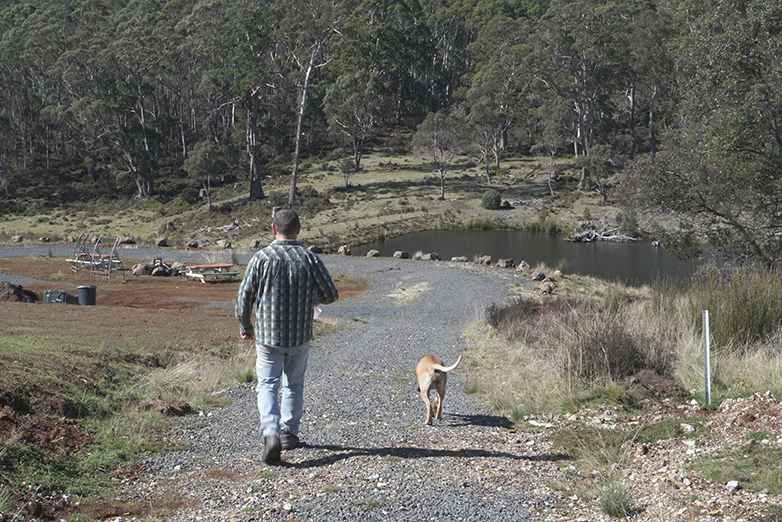 SkyMesh customer with his dog on his property