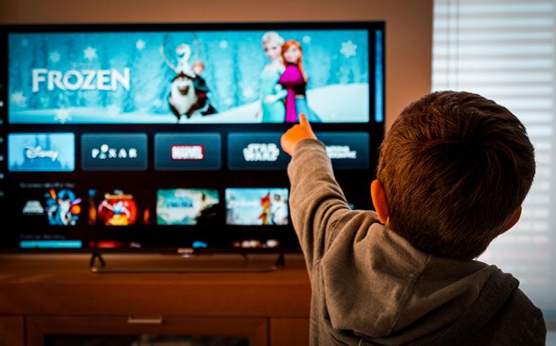 Little boy watches frozen online