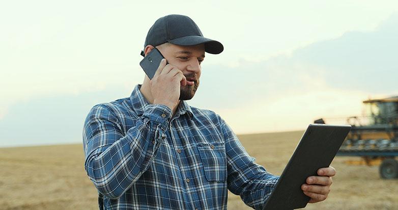Man on phone in field