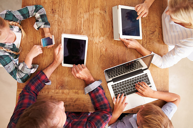 A family using the internet with multiple devices