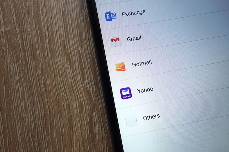 A list of email providers appears on a mobile device