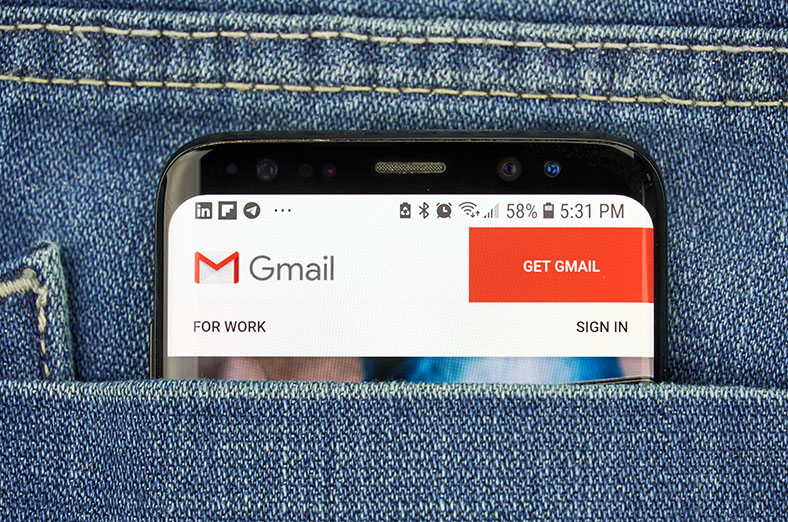 Gmail account appears on mobile phone in person's pocket