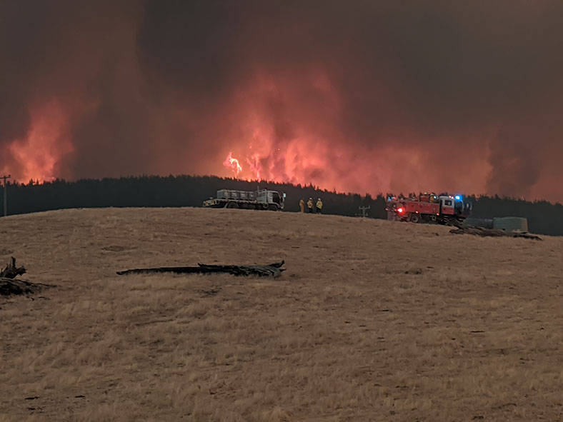 2020 Get Snapping competition entry from Gavan Willis featuring a bushfire tearing through a rural Australian scene