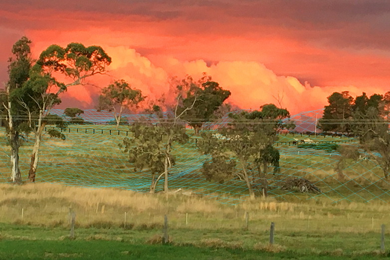 Image of rural landscape with bushfire background. SkyMesh mesh branding element applied as top layer